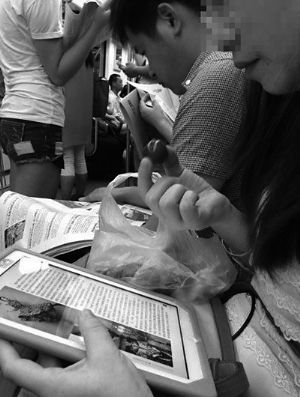 A woman is eating grapes in subway