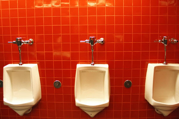 Three male urinals/toilets.