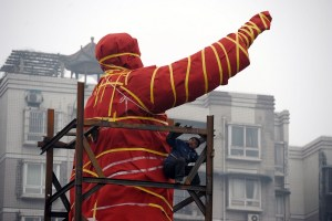 A cement statue of Mao Zedong errected in 1968 during the Cultural Revolution being relocated in Chongqing.