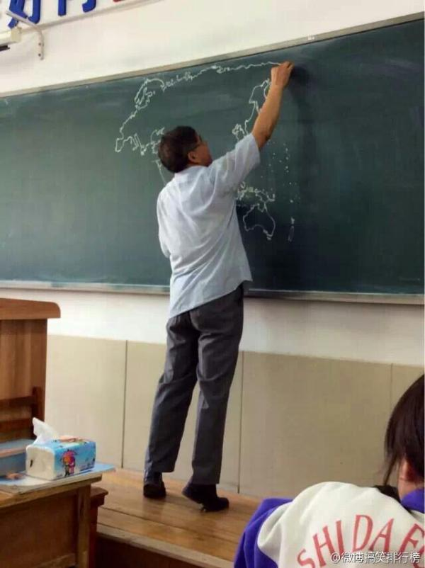 chinese-teacher-freehand-draws-world-map-on-chalkboard-in-class-04