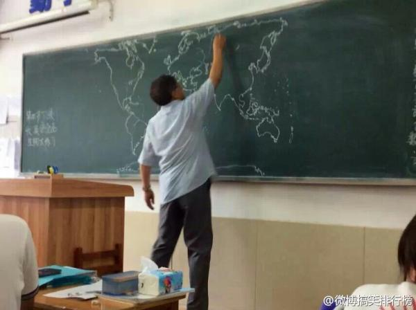 chinese-teacher-freehand-draws-world-map-on-chalkboard-in-class-06