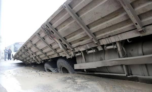 Truck Falls Through Road