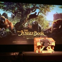 While waiting for the film to begin, an organist plays Disney songs