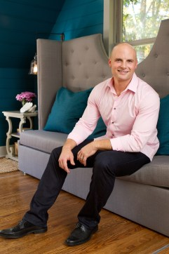 Host and licensed contractor Chip Wade in the Van Hattum's renovated master suite, as seen on HGTV's Elbow Room. After the master suite renovation by licensed contractor Chip Wade, the Van Hattum's now have a beautiful master suite and bathroom for these newlyweds in Atlanta, Georgia. Before the renovation, the previous homeowners left a half-finished suite, an angled roofline and lots of unused space. (portrait) (HGTV,Elbow Room, Chip Wade, Van Hattum, after, master suite, bathroom, renovation, portrait)