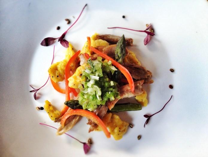 Starters at Quantus - Szechuan duck leg confit, saffron spaetzle, asparagus, peppers, green salsa criolla.