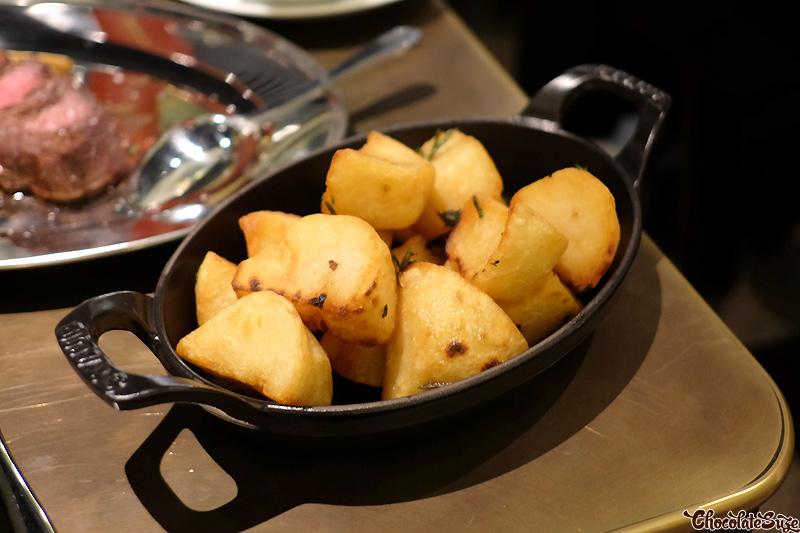 Dripping potatoes, roasted garlic cream fraiche at Mercado Restaurant, Sydney