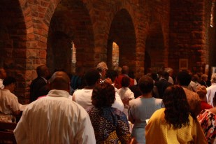 The congregation listen to the Gospel reading