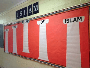 """""""Because of the misunderstanding … the bulletin board has been taken down until the unit is taught later this fall,"""" the district explained. [photo: Christian News Network]"""