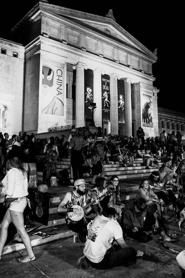 "CHICAGO, ILLINOIS - JULY 4, 2015 - Hundreds of Deadheads gather on the steps of Chicago's Soldier Field to view fireworks during the Grateful Dead's second ""Fare Thee Well"" show."