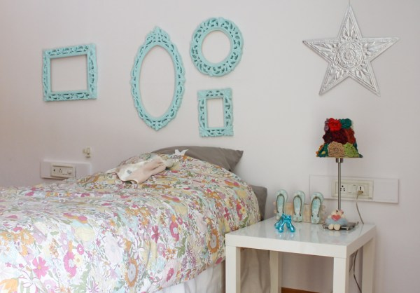 girls room with blue pompoms & frames-8