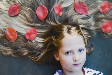 family photographer sydney - girl with autumn leaves