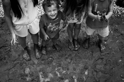 family photography sydney - playing in mud