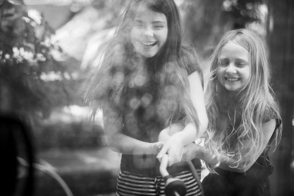 family photography sydney - girls playing with hose