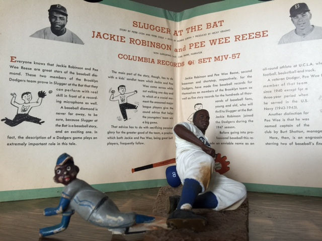 Jackie Robinson figurines, 1947 (left) and late 20th century (right). From the collection of Howard Warren.