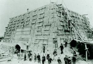 Men at the base of the unfinished pedestal C. 1884.