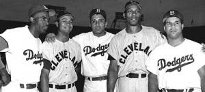 Jackie Robinson, Larry Doby, Don Newcombe, Luke Easter and Roy Campanella posing for a photo as professional Baseball players