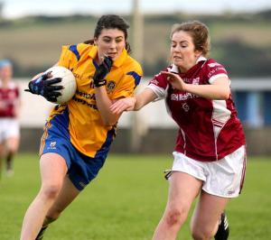 Banner's Aoibheann Malone under pressure from Liscannor's Roisin Rouine during their Senior Championship Final at Cooraclare on Saturday. Photo Arthur Ellis.