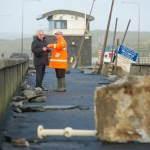 County manager Tom Coughlan and local businessman Odran O Looney view of some of the storm damage at Lahinch promenade. Photograph by John Kelly.