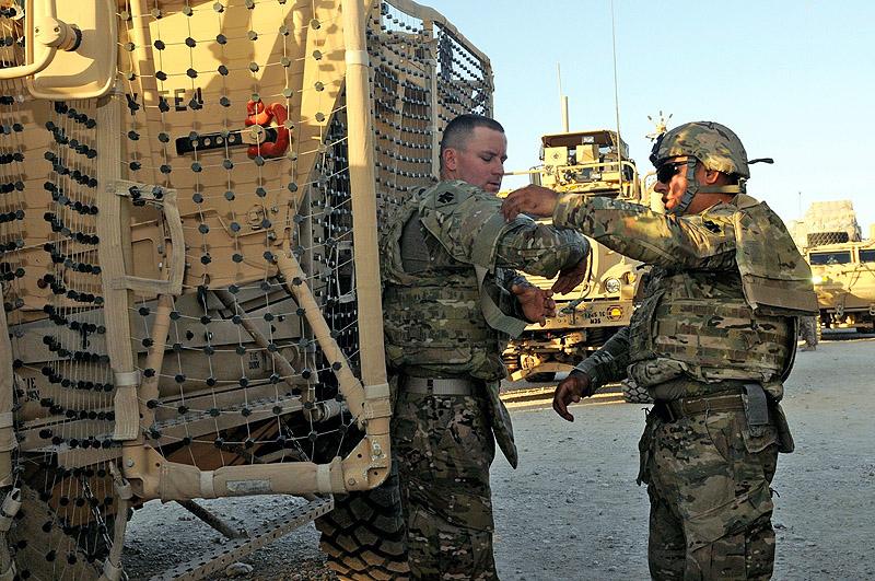 US Army Sgt Osbaldo Espinoza, right, a platoon team leader, and