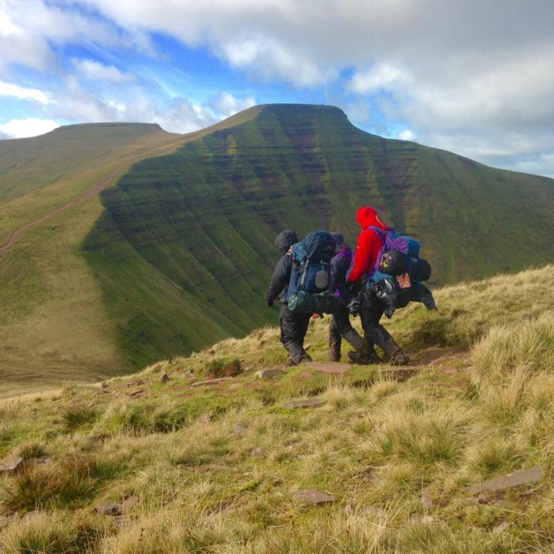 The team on their Gold DofE exped nearing the summit of Pen y Fan