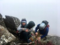 Sina being looked after by two MIA trainees on the Parsons Arête..