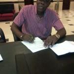 Buro Banton signing his contract