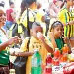 Children sampling the various drinks at the Grace booth
