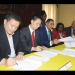 Liu Xiangang, (left), project manager China Harbour Engineering Company; Niu Qingbao, (second left) Chinese Ambassador to Jamaica, and Prime Minister Andrew Holness, (third left) sign the agreement for the Barbican Road upgrading work.