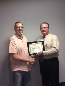 Bruce Parry, CVO Chair, presents the Certificate of Appreciation to Joe Bazil. Joe was unable to attend the awards luncheon at which it was awarded.