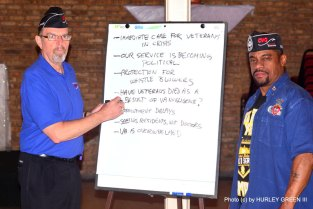 Bruce Parry, CVO Chair, with Darryl Howard, CVO Treasurer, taking notes at the Town Hall Meeting.
