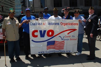 "CVO members line up before the parade: Kariem Muhammad, Howard Noey, Taalibdin Shabazz, David Roger, Darryl Lockhart, Bruce Parry, Abundio ""Al"" Zaragoza, Christopher Lafayelle"
