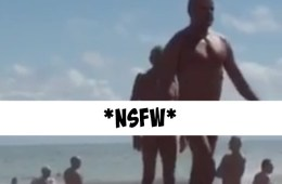 WATCH: There's One Hell of a Sea Snake on the Loose at This Nudist Beach [NSFW]