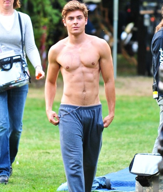 """©NATIONAL PHOTO GROUP Zac Efron films scenes for his upcoming film """"The Death and Life of Charlie St. Cloud."""" On set Zac chases geese with trash can tops and eventually comes to take his shirt off. It appears that he drops down to do push ups to stay pumped on set. Job: 082209J2 PREMIUM EXCLUSIVE August 21st, 2009 Burnaby, British Columbia nationalphotogroup.com"""