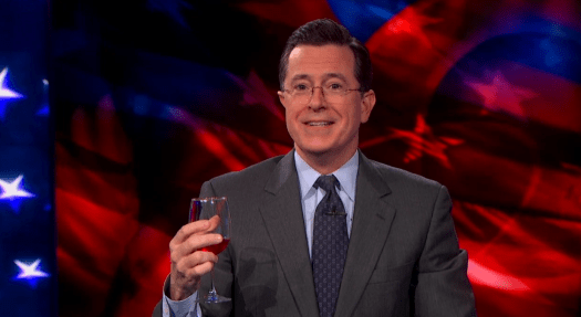 Stephen Colbert drinking wine