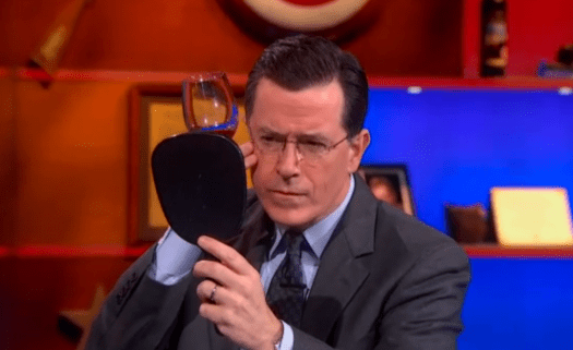 Stephen Colbert looking into mirror