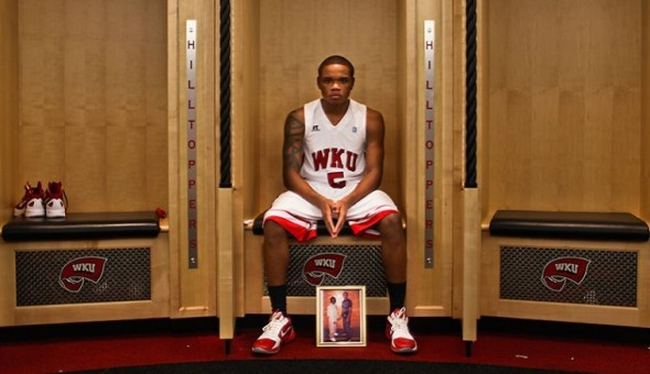 WKU freshman guard Derrick Gordon sits by a photo of him and his fraternal twin brother, Darryl, at his locker in Diddle Arena. Derrick has dedicated his basketball career to Darryl, who has been in prison since 2009 for attempted murder. (Photo by Austin Koester/Herald)