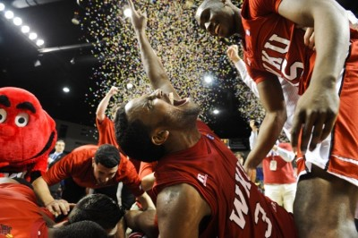 Senior guard Kahlil McDonald celebrates with his teammates after winning the Sun Belt Conference Tournament against North Texas on March 6 in Hot Springs, Ark. WKU defeated North Texas 74-70 to earn an automatic berth in the NCAA Tournament — its first since 2009. (Jabin E. Botsford/Herald)