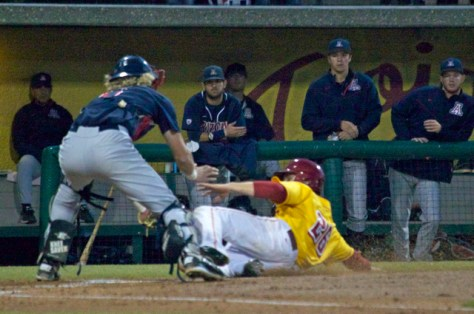 Blake Lacey is hosed at the plate. (Photo: Shotgun Spratling)