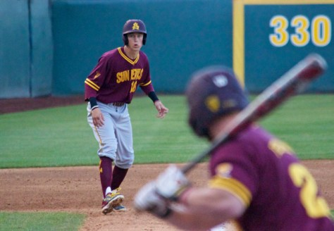 Johnny Sewald leads off third base in the first inning.