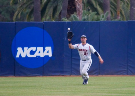 Aaron Brown makes a catch in CF. (Photo: Shotgun Spratling)