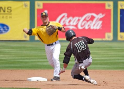 Colton Vaughn turns the double play. (Photo: Shotgun Spratling)