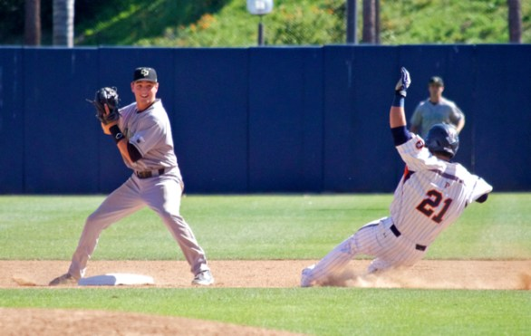 Ryan Rosa can't get a ball out of his glove to turn the double play. (Photo: Shotgun Spratling)