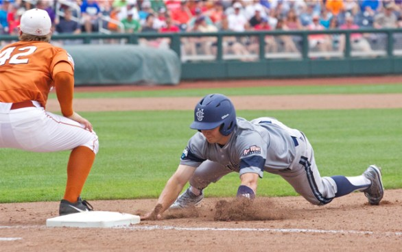 Adam Alcantara dives back to first. (Photo: Shotgun Spratling)