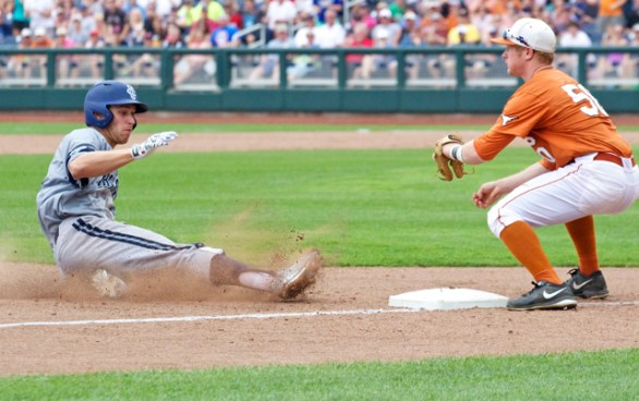 Taylor Sparks slides in with an RBI triple. (Photo: Shotgun Spratling)