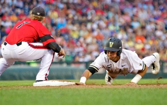 Vince Conde dives back into first base. (Photo: Shotgun Spratling)