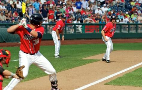 Pitcher Aaron Greenwood leads off third base. (Photo: Shotgun Spratling)