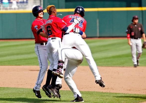 Ole Miss teammates tackle John Gatlin. (Photo: Shotgun Spratling)