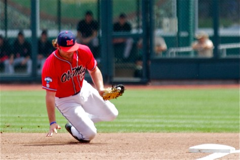 Sikes Orvis makes a sliding stop at first base. (Photo: Shotgun Spratling)