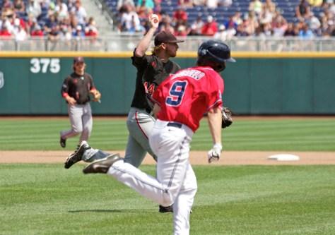 Ryan Moseley tosses to first. (Photo: Shotgun Spratling)
