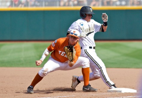 Tyler Campbell scampers back as Kacy Clemens catches. (Photo: Shotgun Spratling)